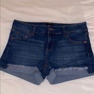 cuffed dark blue jean shorts